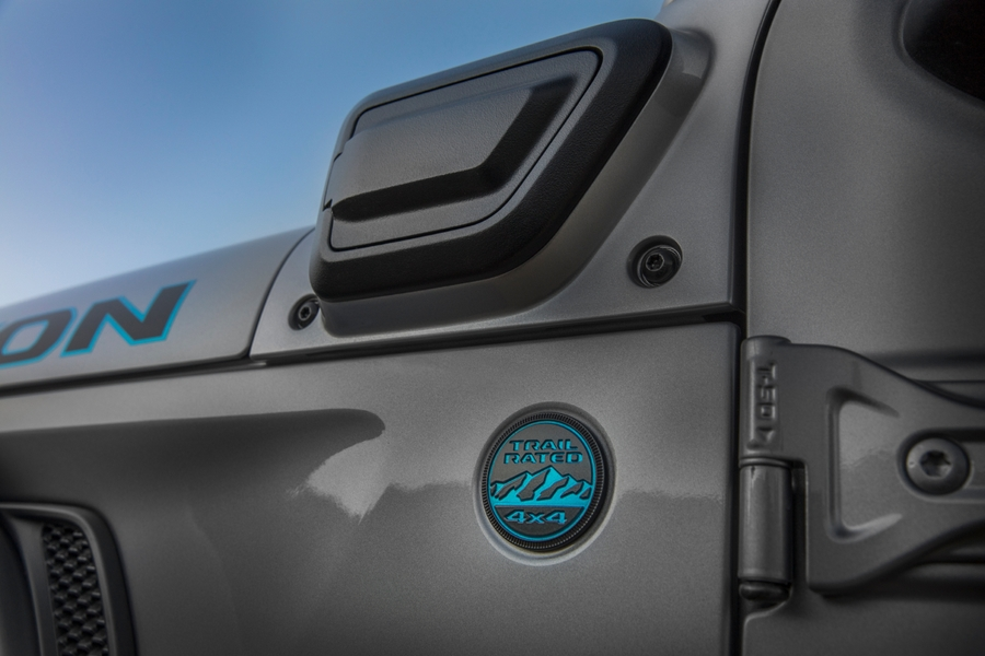 The charge port on the 2021 Jeep® Wrangler 4xe is mounted on the left cowl. The charge port is covered with a push open/push close door.